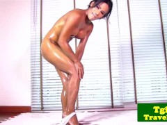 Oiled tgirl Janet loves a big dildo in ass