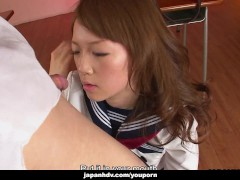 Aroused Asian schoolgirl sucking on the teachers hard dick