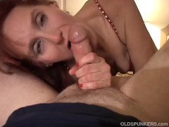 Kinky old redhead is so horny she fucks the cameraman