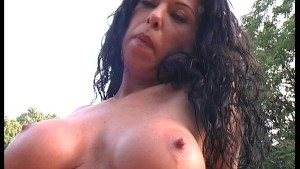 Big boobed brunette gets down with fruit