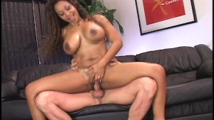 Brown sugar bombshell rides big white cock