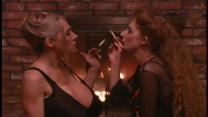 Hot redhead and big busted blonde share a smoke