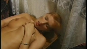 Hot redhead takes things in her hand and mouth