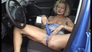 Pierced old lady playing in a bug (clip)