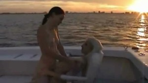 2 sexy lesbos making out on a boat