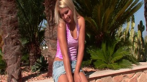 Hot blonde Brandy Smile showing off her body outdoors