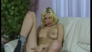 Young blonde babe Cornelia with pink dildo
