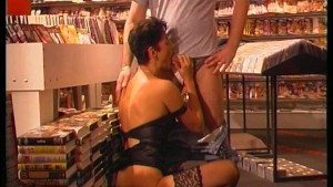 Brunette double fucked in the porn shop