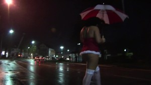 Scantily clad girl takes a walk in the rain
