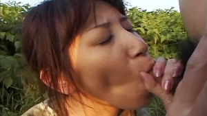 Asian chick acts naughty in the grass