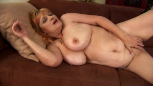 Mature Gunda masturbates with red dildo