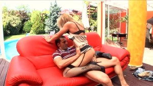 Uniformed babe in fishnet stockings and garter
