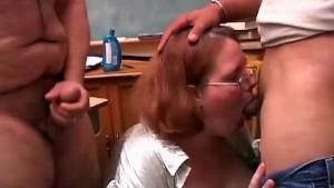 Cute chubby redhead sucks two cocks
