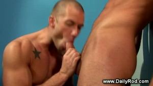 Gay jock returns the blowjob in the restroom to gay hunk