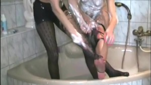 Bisexual babes tease in wet ripped up pantyhose