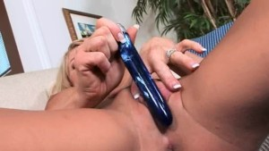 Busty slut using huge glass dildo