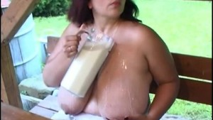 extreme boobs playing with milk
