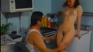 Vintage sex movie with couple on a kitchen
