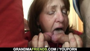 Old woman takes it from both ends
