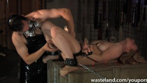 Blonde sex slave is treated to industrial hardcore pleasure pain