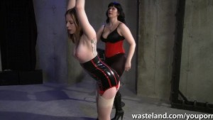Tattooed slave is whipped hard by her dominant mistress