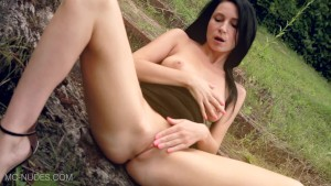 Black haired MILF Kat mastubates outdoors - see her wet pussy