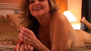 Naughty MILF plays with her pussy and blows the cameraman