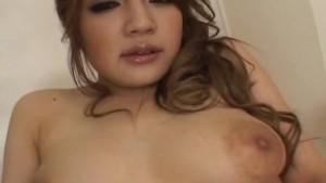Mai Miyama in socks puts vibrator on clit