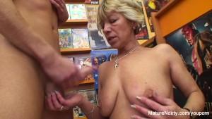 Granny fucks a guy in the video store