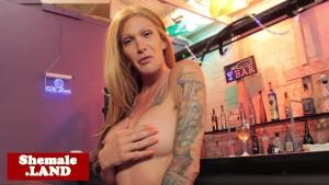 Teasing inked tgirl masturbates inside a bar