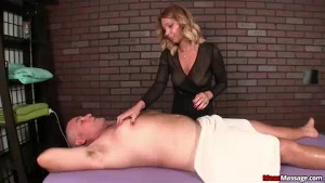 Milf Masseuse Teases Client s Cock With Vibrator