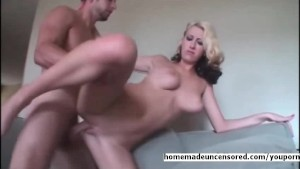 Busty blond amateur fucked on the couch