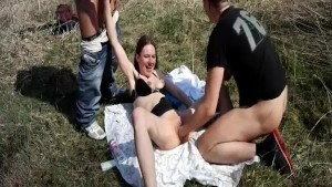 Shameless amateur teen fisted and fucked by two brutes at a public park