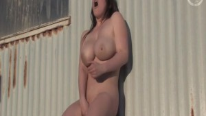 busty brunette masturbating outdoors.mp4