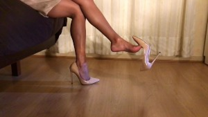 Dangling naked legs and cream heels