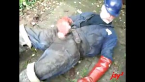 guy in dirty overalls and waders is wanking and cums with gloves
