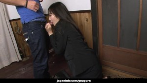 asian brunette blowing hard on a big cock