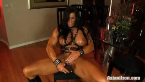 Huge muscular chick takes the huge black dildo