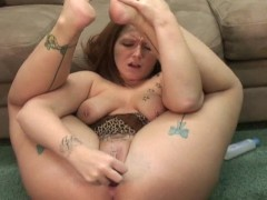 Cute redhead Zoe plays with a toy