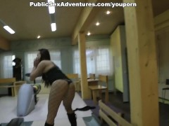 Super-flexible chick blowing, while guys play bowling