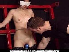 Endearing Japanese chick moans while being whipped