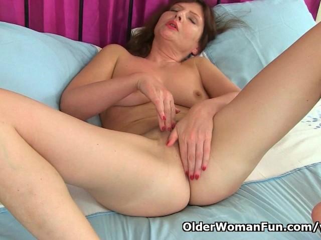 German milf Kristine Von Saar finger fucks her hairy pussy
