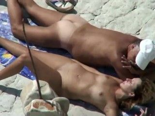 Mom and dad fuck on a public beach...
