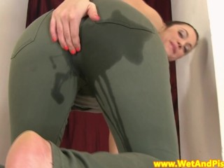 Pissing babe gives herself...