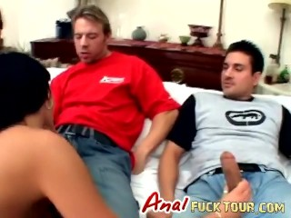 Horny brunette enjoys two big cocks...