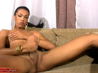 Kinky black tranny slaps tight ass and strokes her girl rod